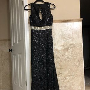 Gown never worn, black sequin stretch, fits size 6